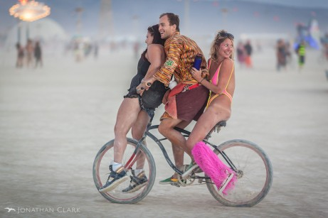burning-man-2013-cargo-cult-black-rock-city-playa-jonathan-clark-three-people-on-bicycle